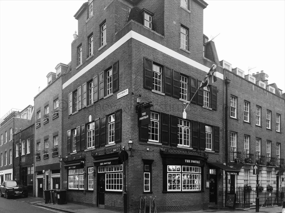 The 'Running Footman', Charles Street, Mayfair, London W.1. The Footman Pub Public House Watney, Combe, Reid & Co., Ltd.